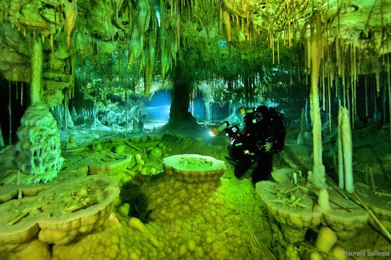 Laurent exploring a sub-aquatic cave somewhere in Spain