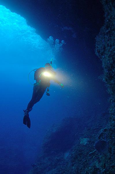 Diver_exploring_cave,_Monito_Island,_Puerto_Rico
