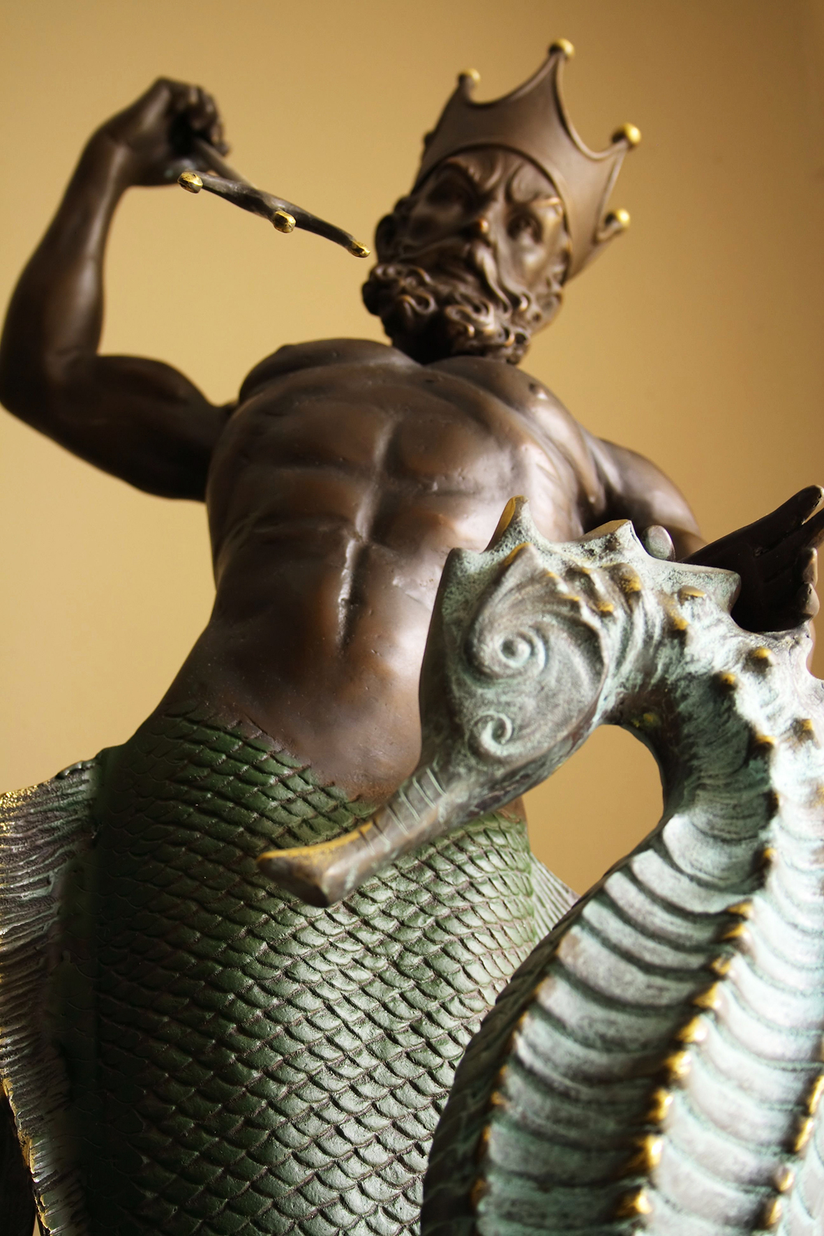 A statue of the Roman god Neptune with a seahorse © mmorell