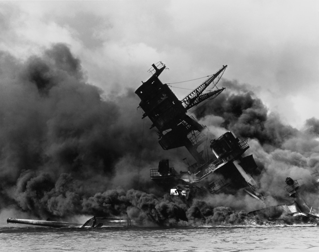 """The USS Arizona (BB-39) sunk and burning during the attack on Pearl Harbour, 7 December 1941"" © Wikimedia Commons"