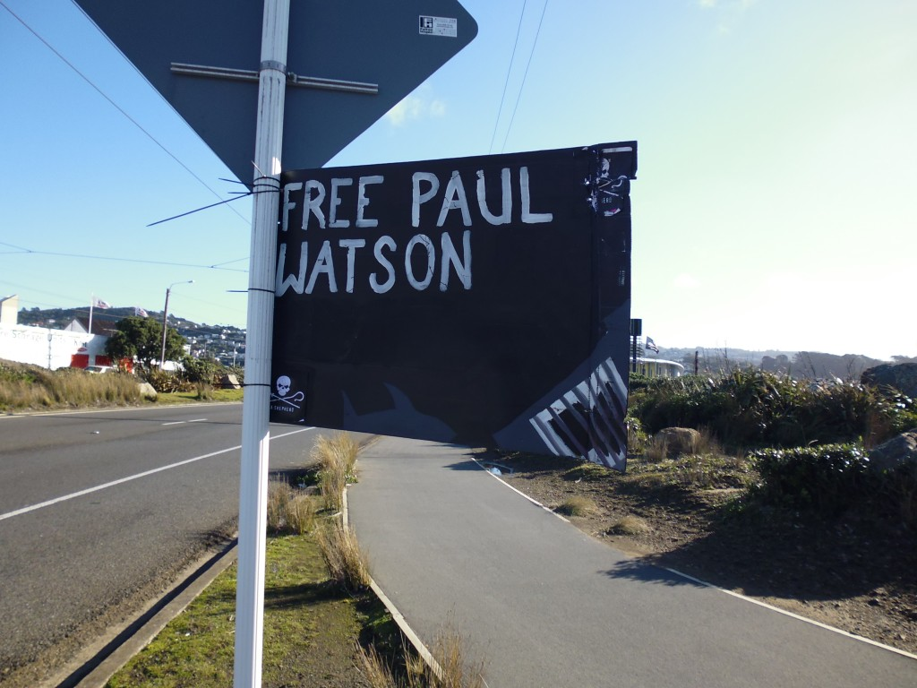 A sign calling for the dropping of charges against Watson, Wellington International Airport © William Stadtwald Demchick