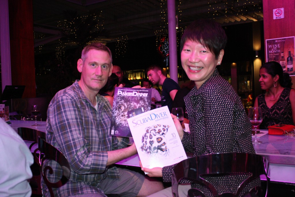 Two guests with their complimentary Scuba Diver and Asian Diver magazines