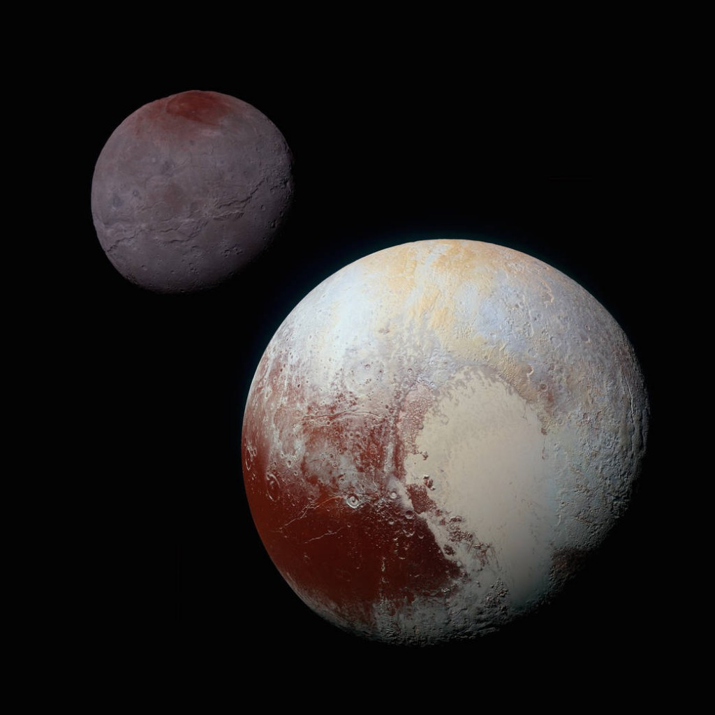 This composite of enhanced color images of Pluto (lower right) and Charon (upper left), was taken by NASA's New Horizons spacecraft as it passed through the Pluto system on July 14, 2015. © NASA Public Domain