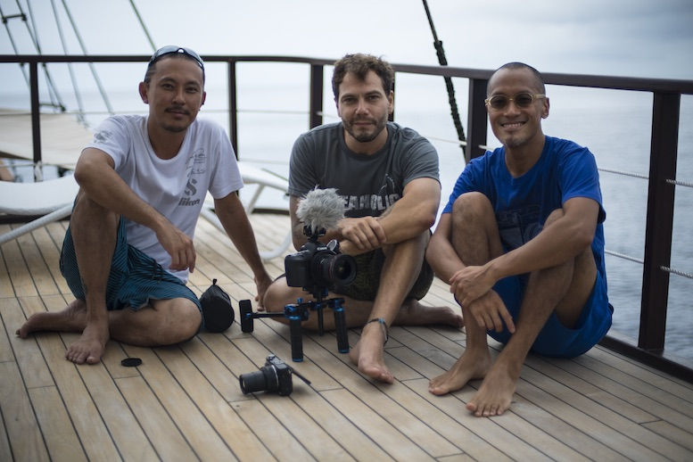 "ADEX Ambassador of Photography Aaron Wong, Professional Underwater Videographer Pepe Arcos, and Professional Underwater Photographer Alan Lo, chilling on the deck. ""We want to support them in doing this sustainably; respecting traditional marine tenure, securing the future livelihoods for local fishermen and their families, as well as the environmental future of the area for future generations."""
